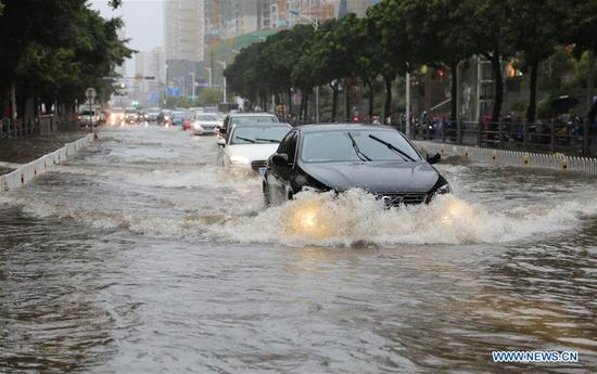 Hainan hit by heavy rainfalls due to tropical depression