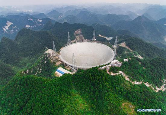 Photo taken on Sept. 7, 2016 shows the Five-hundred-meter Aperture Spherical Telescope (FAST) in Pingtang County, southwest China's Guizhou Province.  (Photo: Xinhua/Liu Xu)