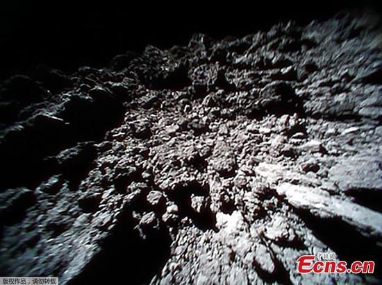 Japan's space rover releases new photos of asteroid surface